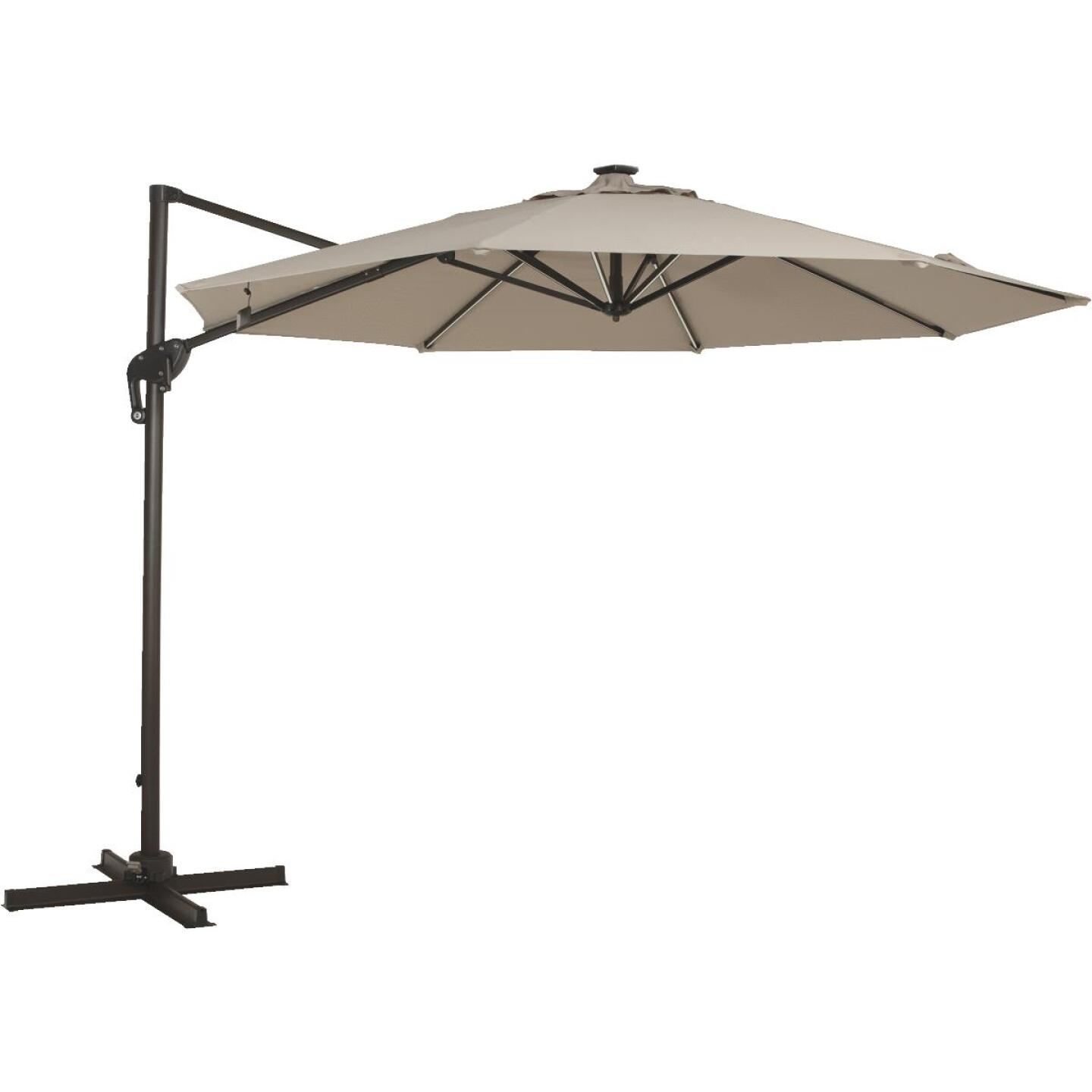 Outdoor Expressions 10 Ft. Offset Cream Patio Umbrella with Solar LED Light Image 1